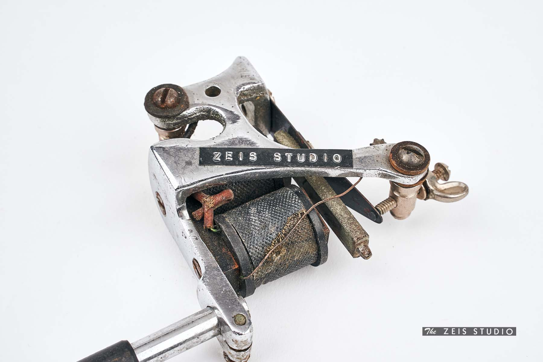 Closeup of Charlie Geizer Tattoo Machine with The Zeis Studio logo on it. From Milton Zeis's personal collection.