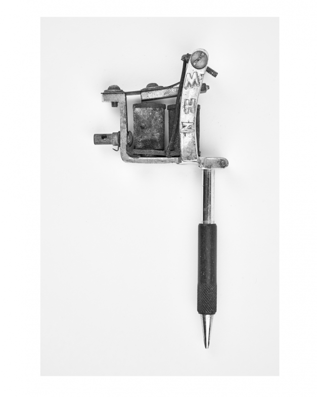 A print in black and white of a Spaulding and Rogers tattoo machine